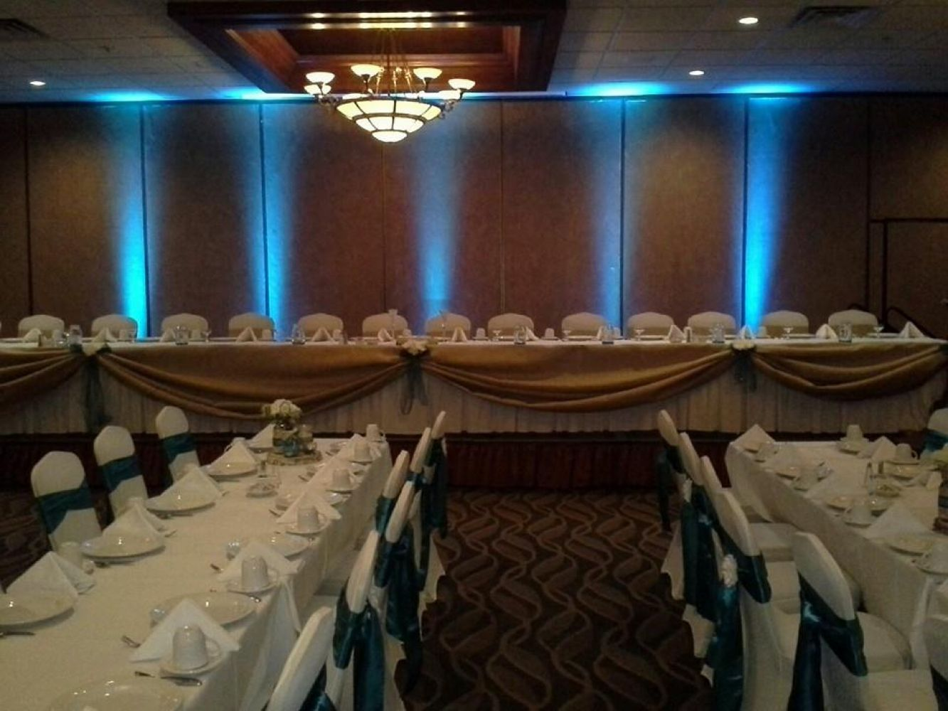 Dramatic Uplighting With White And Dark Teal