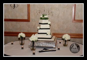 Classic White & Black 4 Layer Cake with Rose Accents